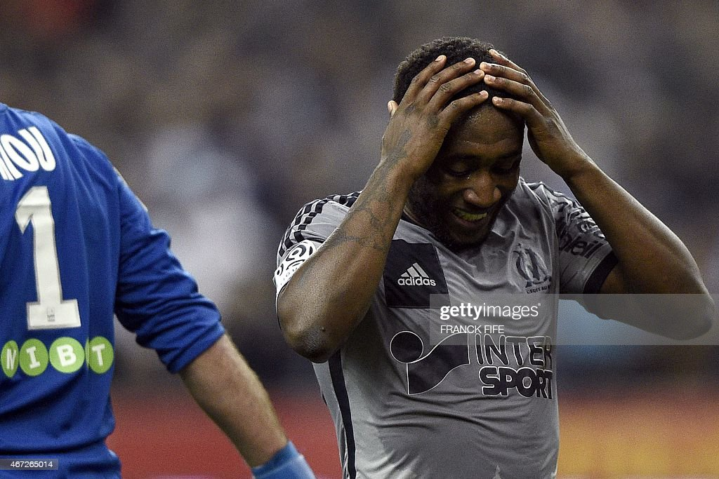 Marseille's Ivoirian defender Brice Dja Djedje reacts after missing a goal during the French L1 football match between Lens and Marseille on March 22, 2014 at the Stade de France in Saint-Denis, north of Paris.
