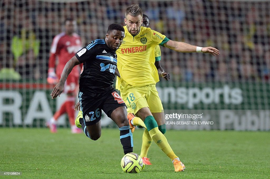 Marseille's Ivoirian defender Brice Dja Djedje (L) vies with Nantes' French midfielder Lucas Deaux during the French L1 football match between Nantes and Marseille on April 17, 2015 at the Beaujoire stadium in Nantes, western France.