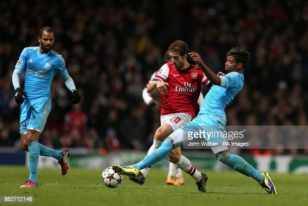 Marseille's Mario Lemina and Arsenal's Mathieu Flamini battle for the ball