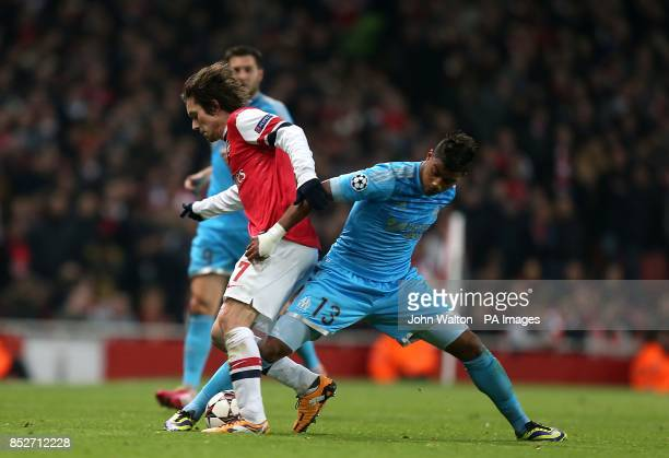 Marseille's Mario Lemina and Arsenal's Tomas Rosicky battle for the ball