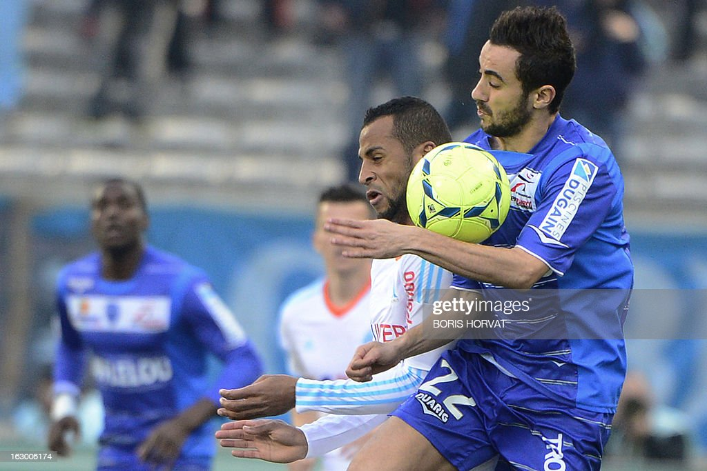 Marseille's midfielder Jacques Romao (L) vies with Troyes' French midfielder Fabien Camus during the French L1 football match Olympique of Marseille vs Troyes at the Velodrome Stadium in Marseille on March 3, 2013. AFP PHOTO / BORIS HORVAT