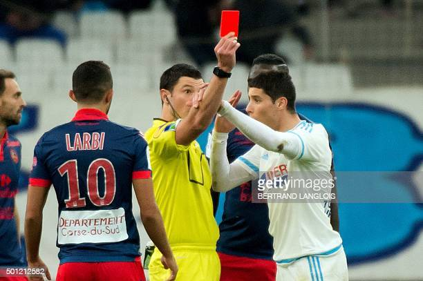 Marseille's Moroccan midfielder Abdelaziz Barrada is given a red card by referee Nicolas Rainville wduring the French L1 football match Olympique de...