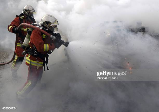 Marseille's naval firefighters put out a car fire during a crowd control exercise attended by more than 500 personnel from criminal investigation and...