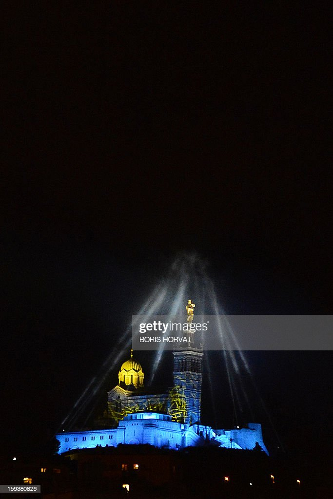 Marseille's Notre-Dame de la Garde basilica, emblem of the city which, is seen enlighted on January 12, 2013 in the French southern city of Marseille, during the light parade, part of the launching of Marseille-Provence 2013 European Capital of Culture. The event marks the start of a year, leading to a cultural renaissance in France's second-largest metropolitan area.