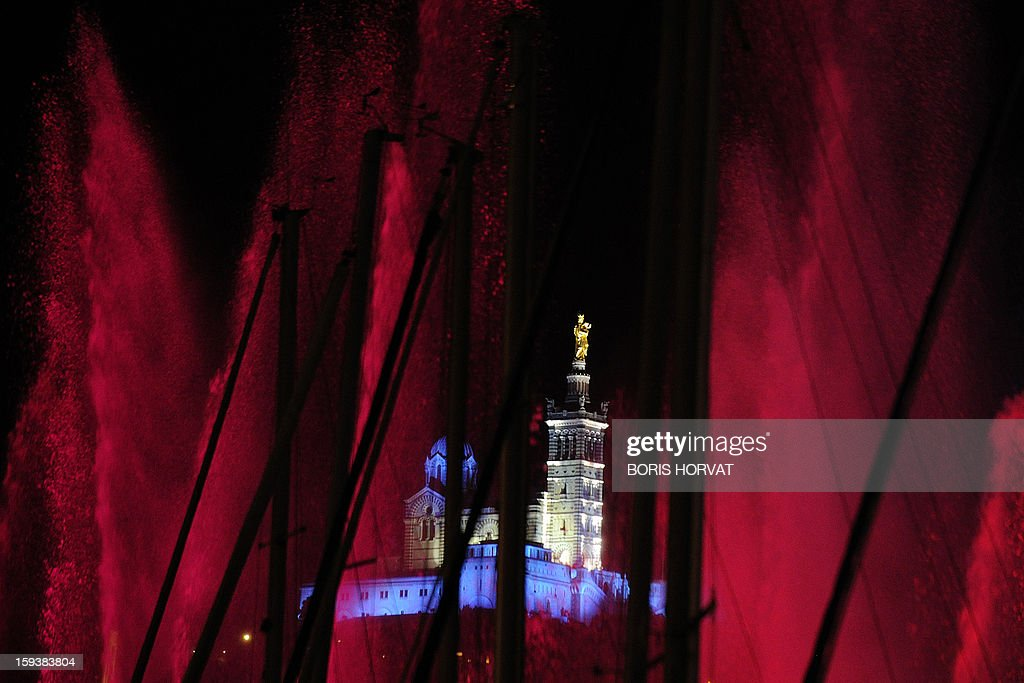 Marseille's Notre-Dame de la Garde basilica, emblem of the city which is seen enlighted on January 12, 2013 in the French southern city of Marseille, during the light parade, part of the launching of Marseille-Provence 2013 European Capital of Culture. The event marks the start of a year, leading to a cultural renaissance in France's second-largest metropolitan area.