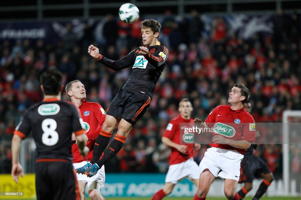Marseille's player Lucas Mendes heads the ball during the French cup football match between Rouen and Marseille at the Robert Diochon stadium on January 30, 2013, in Petit-Quevilly.