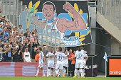 Marseille's players celebrate after Nicolas Nkoulou scored during their French L1 football match Olympique de Marseille versus Toulouse at the...