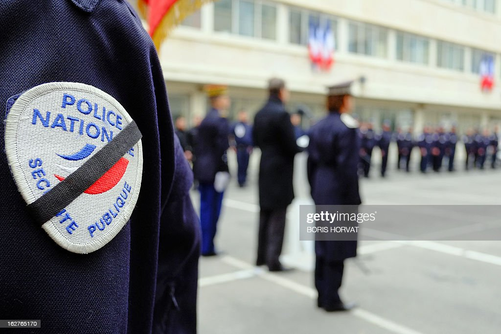 Marseille's policemen pay homage, on February 26, 2013, in Marseille, southern France, to their two colleagues killed in a collision in Paris during a high-speed chase, five days ago. An alleged drunk driver killed the two Paris police officers after slamming his black Land Rover into their cruiser during a high-speed chase on the ring road around Paris. HORVAT