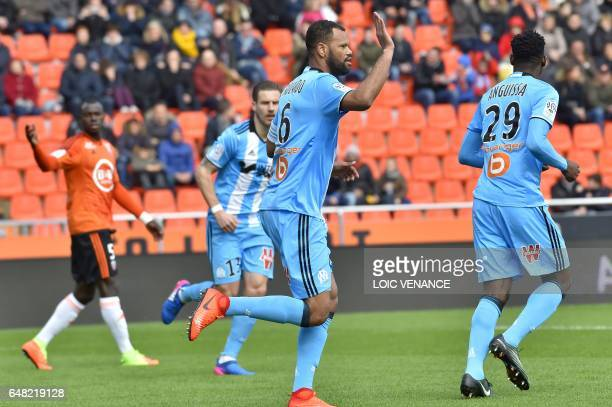 Marseille's Portuguese defender Rolando Jorge Pires Da Fonseca celebrates with teammates after scoring a goal during the French L1 football match FC...