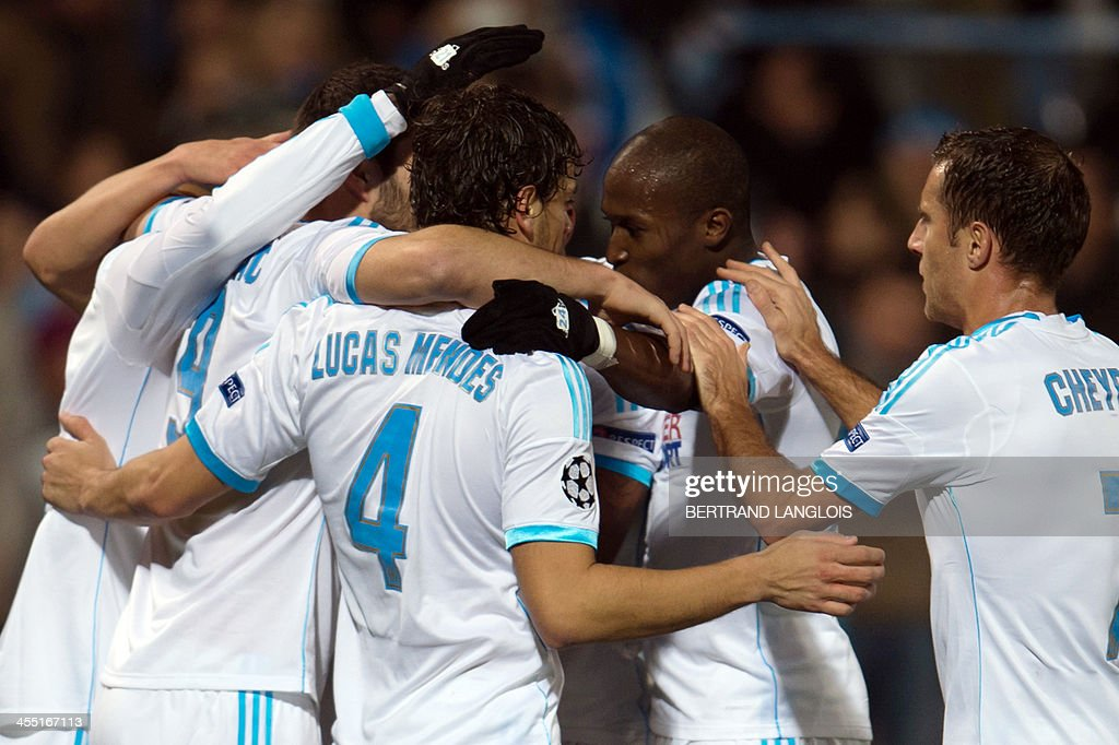 Marseille's Senegalese defender Souleymane Diawara celebrates with team mates after scoring a goal during an UEFA Champions League group F football...