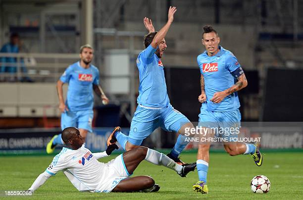Marseille's Senegalese defender Souleymane Diawara fights for the ball with Napoli's Argentinian forward Gonzalo Gerardo Higuain on October 22 2013...