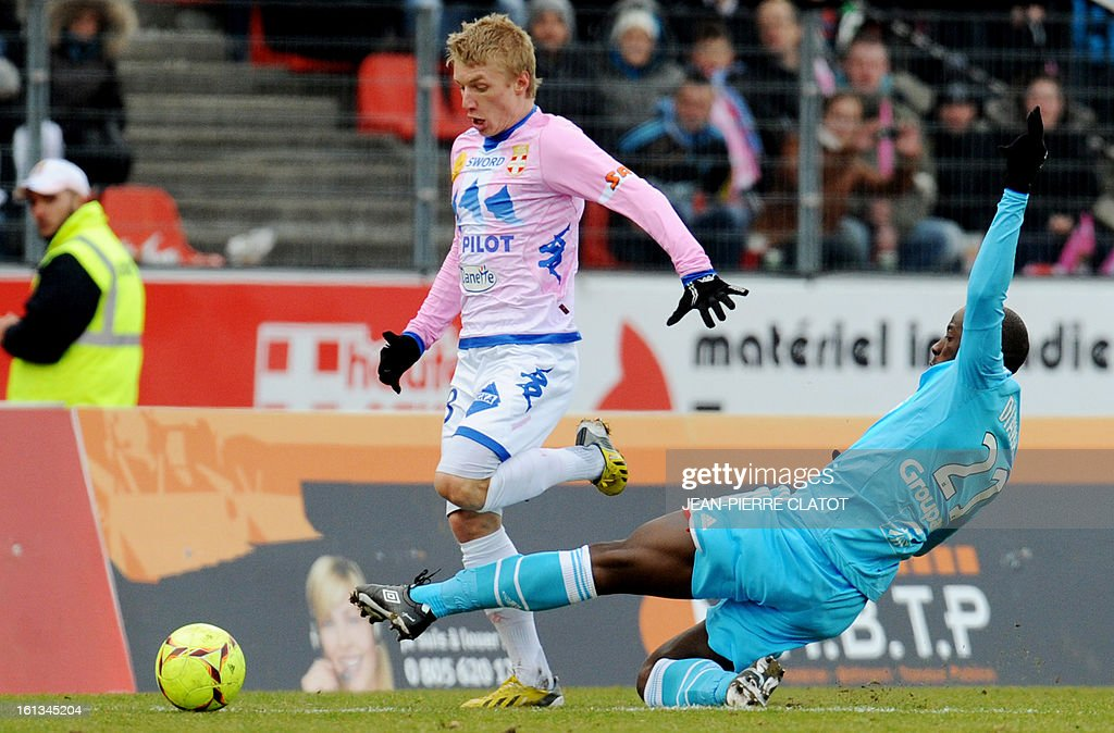 Marseille's Senegalese defender Souleymane Diawara (R) vies with Evian's Danish defender Daniel Wass during the French L1 football match Evian (ETGFC) vs Olympique de Marseille (OM) on February 10, 2013 at the city stadium Parc-des-sports in Annecy, eastern France.