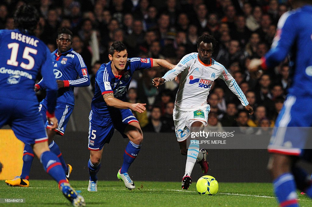 Marseille's Senegalese defender Souleymane Diawara (R) vies with Lyon's Croatian defender Dejan Lovren during the French L1 football match Olympique Lyonnais (OL) vs Olympique de Marseille (om) on March 10, 2013 at the Gerland stadium in Lyon, southeasthern France.