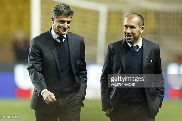 Marseille's Spanish head coach Jose Miguel Gonzalez Martin del Campo aka Michel speaks with Monaco's Portuguese coach Leonardo Jardim ahead of the...