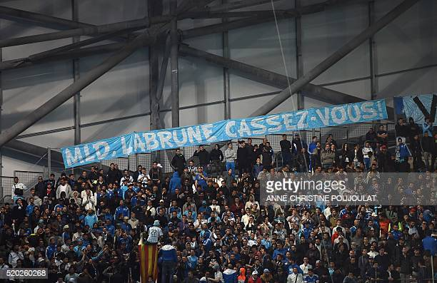 Marseille's supporters display a banner reading 'MLD Labrune get out ' respectively refering to Marseille's owner Margarita LouisDreyfus and...