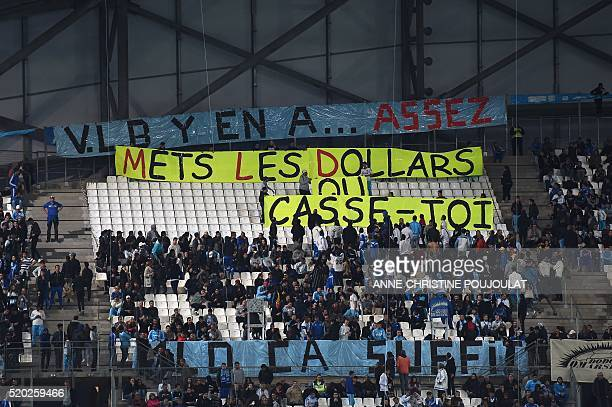 Marseille's supporters display a banner reading 'VLB that's enoughInject dollars or get out MLD that's enough' respectively refering to Marseille's...