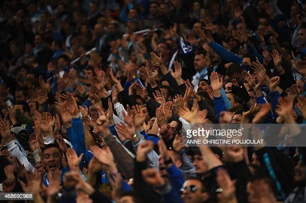 Marseille's supporters react during the French L1 football match between Marseille and Paris Saint Germain at the Velodrome stadium in Marseille...