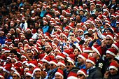 Marseille's supporters wear Santa Claus bonnets as they attend the French L1 football match Marseille vs Lille on December 21 2014 at the Velodrome...