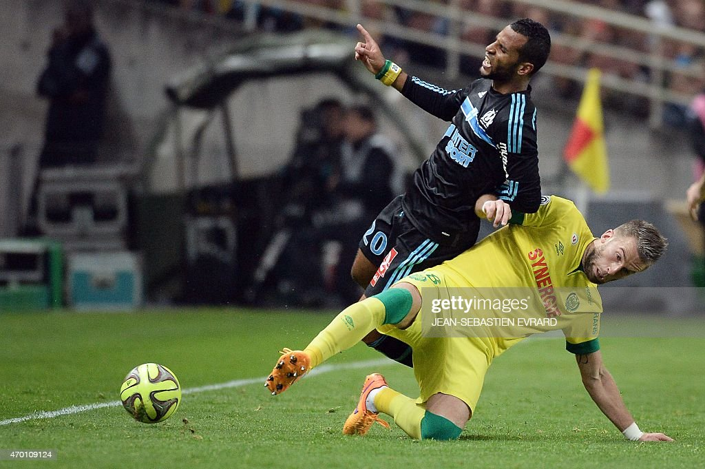 Marseille's Togolese midfielder Jacques-<a gi-track='captionPersonalityLinkClicked' href=/galleries/search?phrase=Alaixys+Romao&family=editorial&specificpeople=554325 ng-click='$event.stopPropagation()'>Alaixys Romao</a> (L) is tackled by Nantes' French midfielder Lucas Deaux during the French L1 football match between Nantes and Marseille on April 17, 2015 at the Beaujoire stadium in Nantes, western France. AFP PHOTO / JEAN-SEBASTIEN EVRARD