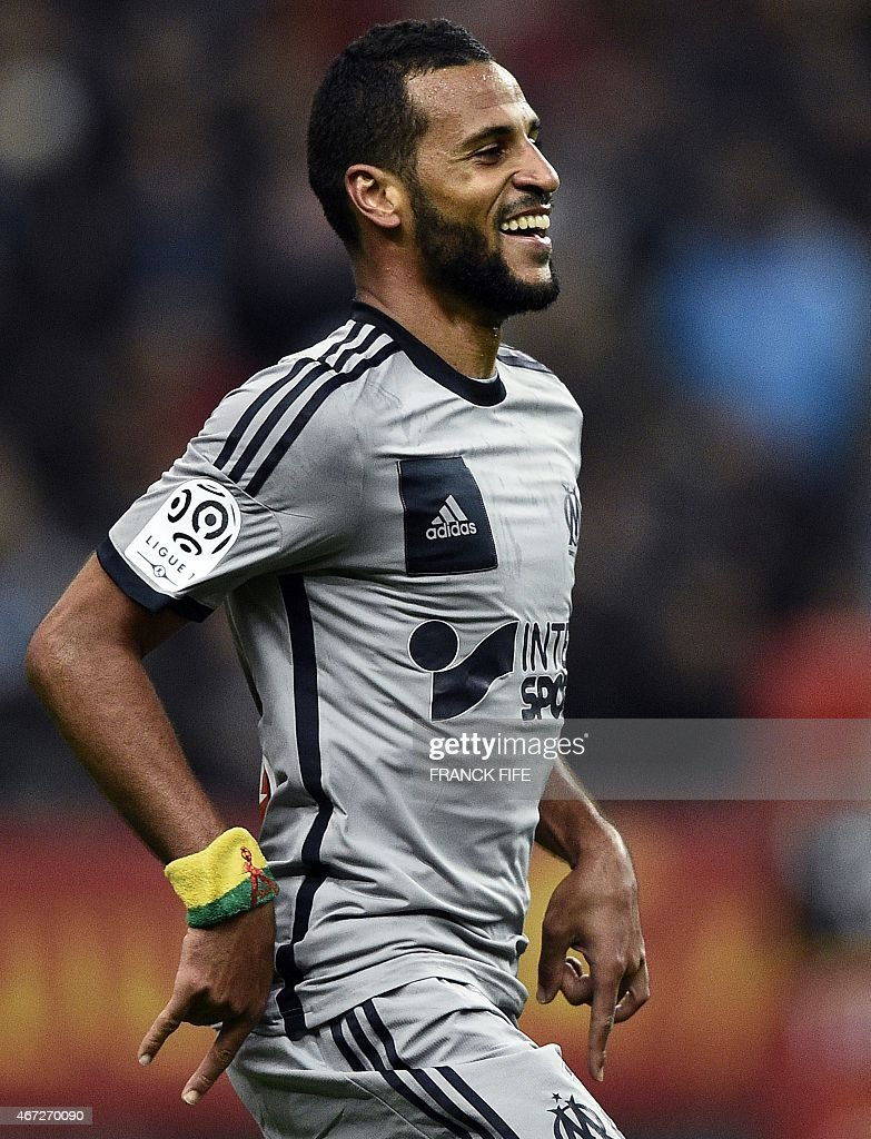 Marseille's Togolese midfielder Jacques-<a gi-track='captionPersonalityLinkClicked' href=/galleries/search?phrase=Alaixys+Romao&family=editorial&specificpeople=554325 ng-click='$event.stopPropagation()'>Alaixys Romao</a> reacts after scoring a goal during the French L1 football match between Lens and Marseille on March 22, 2014 at the Stade de France in Saint-Denis, north of Paris.
