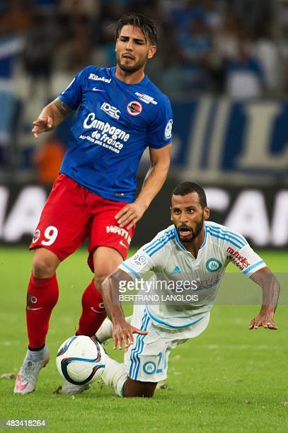 Marseille's Togolese midfielder JacquesAlaixys Romao vies with Caen's French forward Andy Delort during the French L1 football match between...