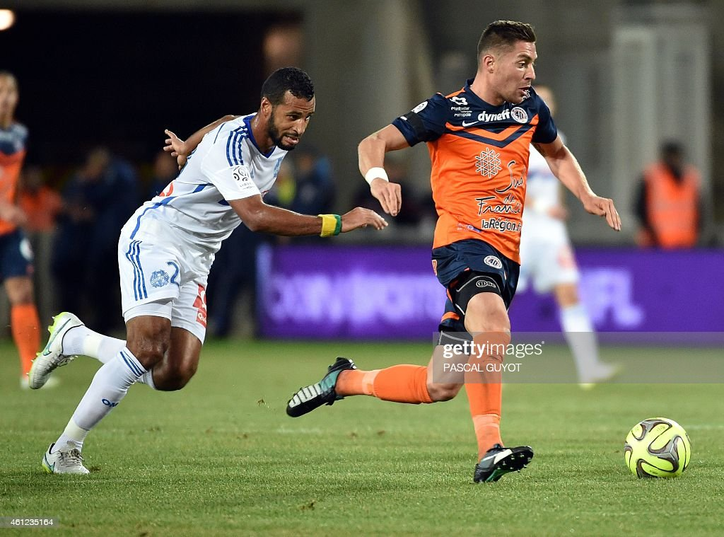 Marseille's Togolese midfielder Jacques-Alaixys Romao (L) vies with Montpellier's French forward Anthony Mounier (R) during the French L1 football match Montpellier vs Olympique de Marseille, on January 9, 2015 at the La Mosson Stadium in Montpellier, southern France.