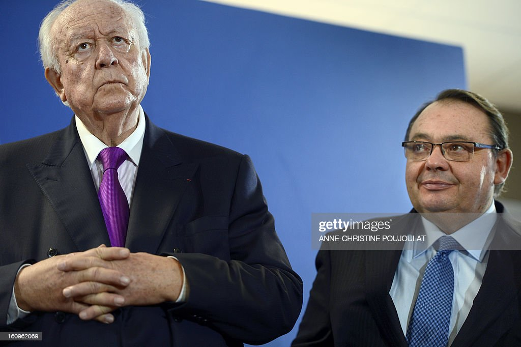 Marseille's UMP right-wing party Mayor Jean-Claude Gaudin (L) and French Socialist MP and deputy Mayor Patrick Mennucci, attend the inauguration of the Urban Supervision Centre (CSU) on February 8, 2013 in Marseille, southern France. AFP PHOTO / ANNE-CHRISTINE POUJOULAT