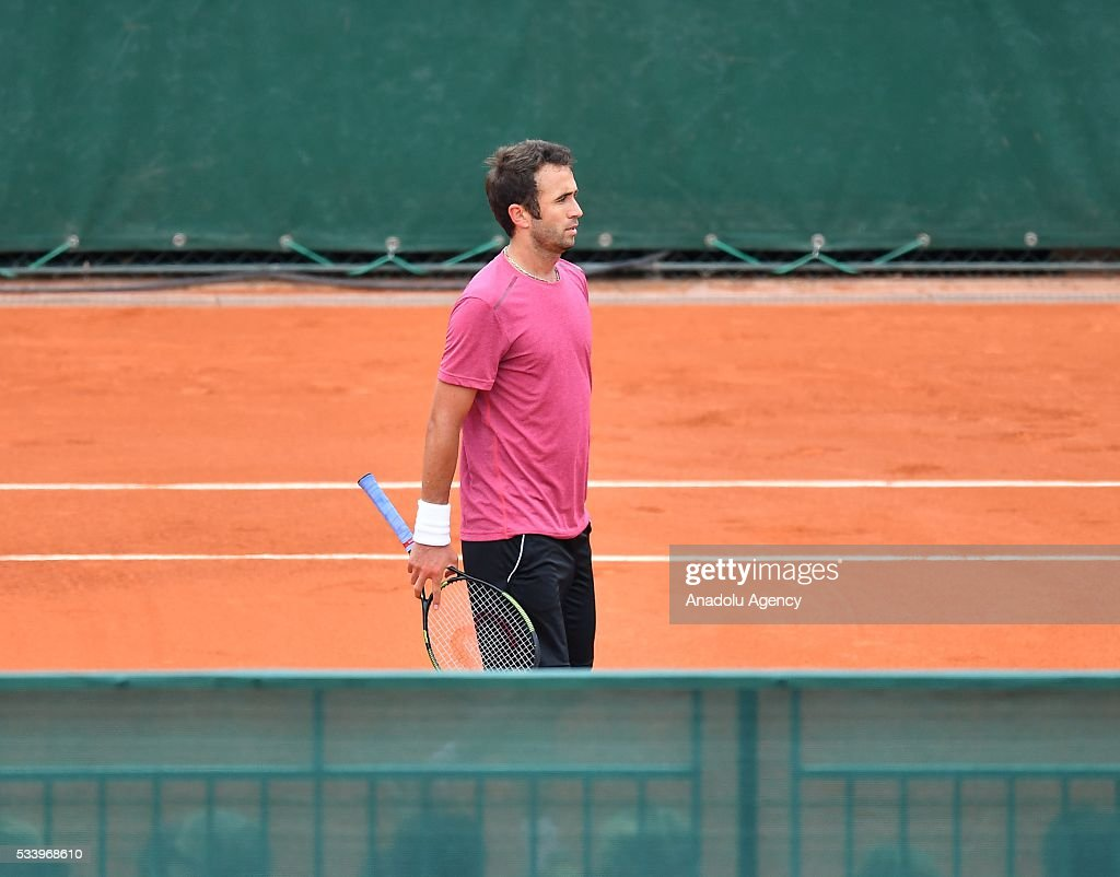 Marsel Ilhan of Turkey leaves after the match against Steve Darcis of Belgium during their men's single first round match at the French Open tennis tournament at Roland Garros in Paris, France on May 24, 2016.