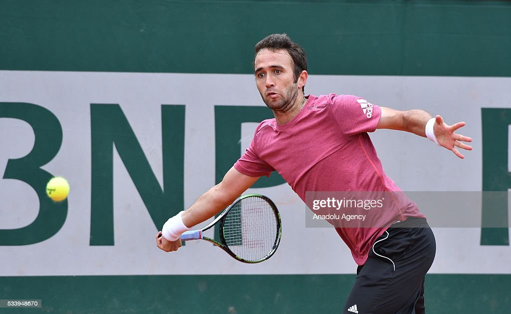 Marsel Ilhan of Turkey returns the ball to Steve Darcis of Belgium during their men's single first round match at the French Open tennis tournament at Roland Garros in Paris, France on May 24, 2016.