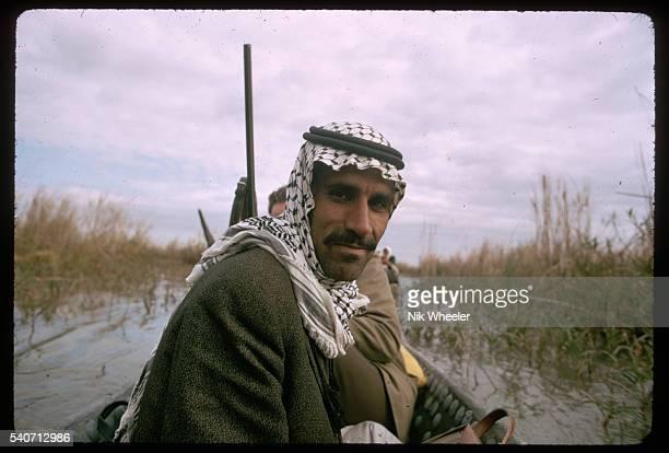 A Marsh Arab man wearing a keffiyeh the traditional Arab headdress Iraq   Location The Marshes near Nasiriya Iraq