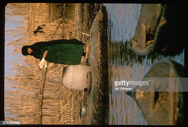 A Marsh Arab woman prepares bread dough which will be baked in a clay oven Iraq   Location The Marshes near Nasiriya Iraq