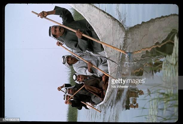 Marsh Arabs in War Canoe