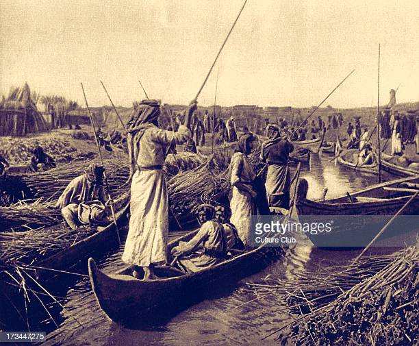 Marsh Arabs village canal in the swamps of the Lower Euphrates First published 1925