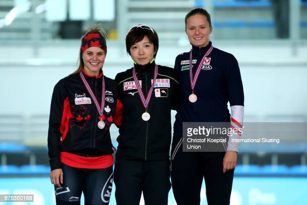 Marsha Hudey of Canada poses during the medal ceremony after winning the 2nd place Nao Kodaira of Japan poses during the medal ceremony after winning...