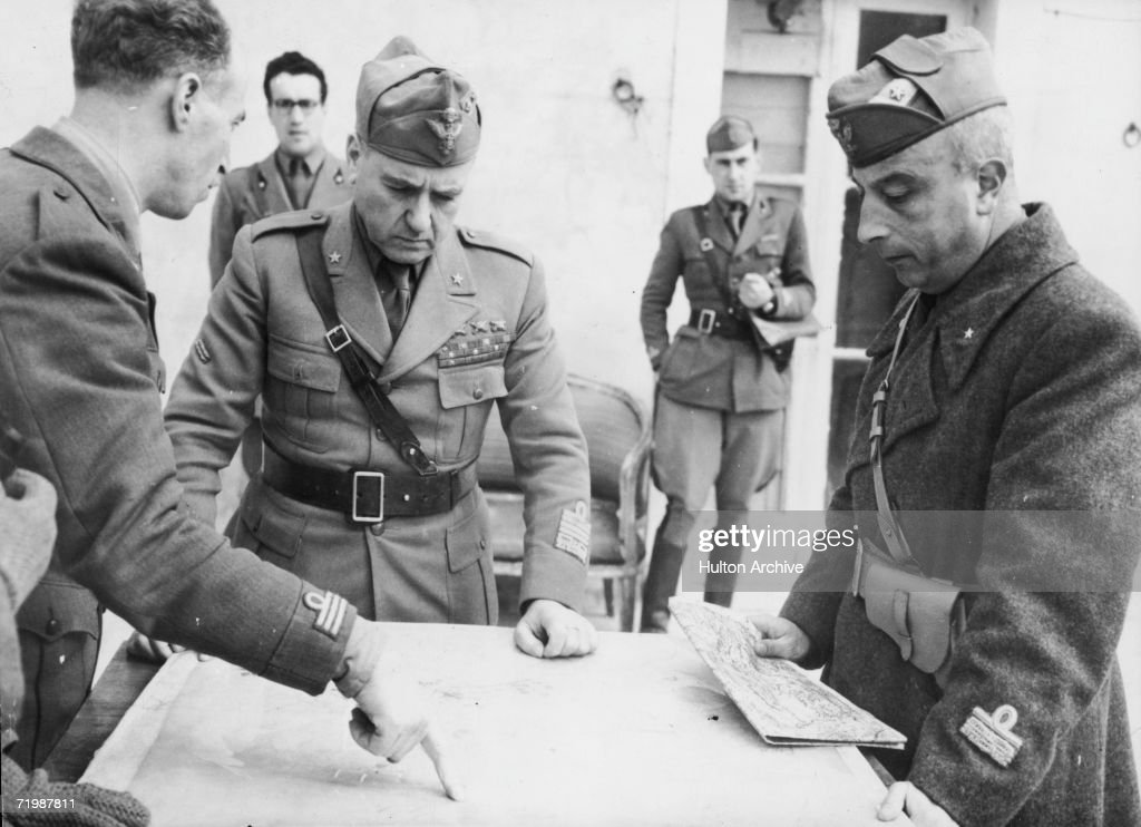 Marshal Giovanni Messe (1883 - 1968, centre), Chief of the Italian General Staff, and General Umberto Utili (right), Commander of the Italian tank corps, discuss strategy with an Italian army captain during World War II, 4th June 1944.