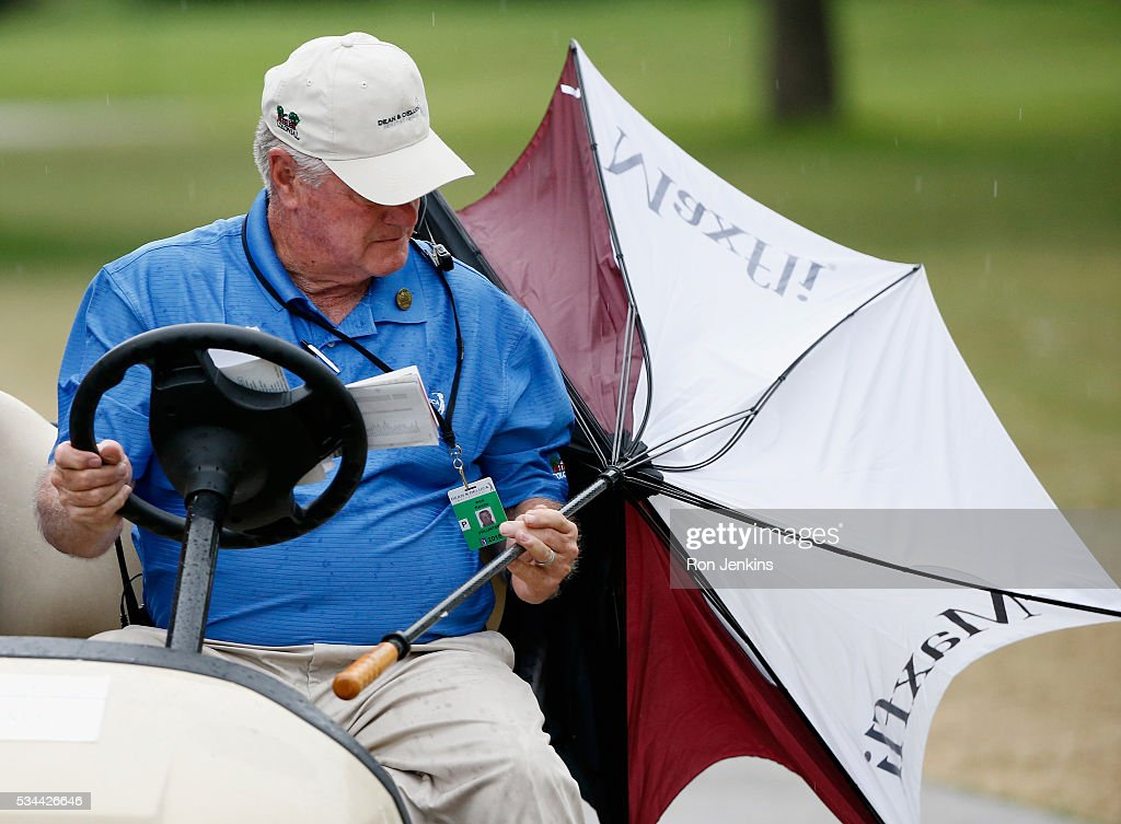 A marshal is seen after play was suspended during the First Round of the DEAN & DELUCA Invitational at Colonial Country Club on May 26, 2016 in Fort Worth, Texas.
