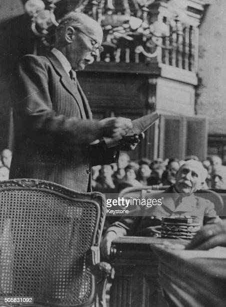 Marshal Philippe Petain the former French War Minister listening to Michel Clemenceau denouncing him and his actions during World War Two at the...