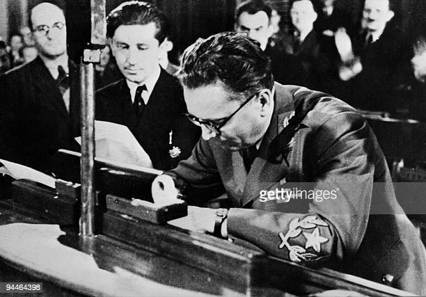Marshal Tito originally Josip Broz signs 07 March 1945 in Belgrade the declaration establishing the Federal People's Republic of Yugoslavia Tito...