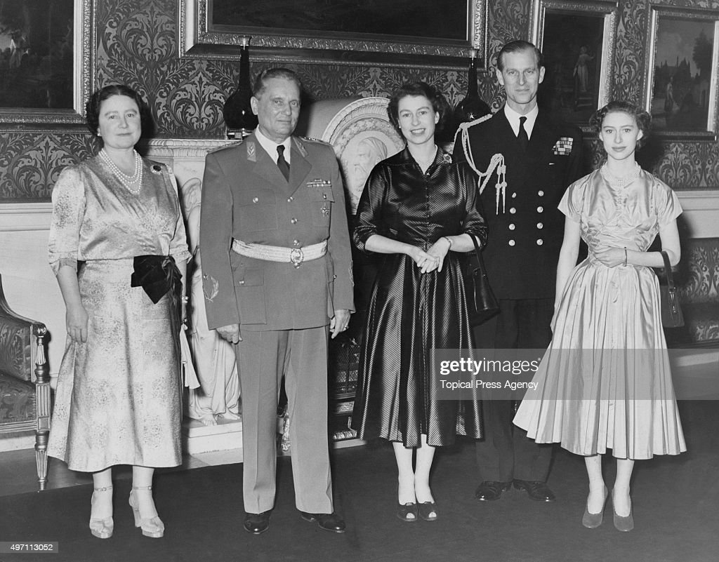 Marshal Tito (1892 - 1980), the 1st President of Yugoslavia, poses with the British royal family after a lunch at Buckingham Palace in London, 17th March 1953. From left to right, the Queen Mother, Tito, Queen <a gi-track='captionPersonalityLinkClicked' href=/galleries/search?phrase=Elizabeth+II&family=editorial&specificpeople=67226 ng-click='$event.stopPropagation()'>Elizabeth II</a>, the Duke of Edinburgh and Princess Margaret in the Picture Gallery at the palace.