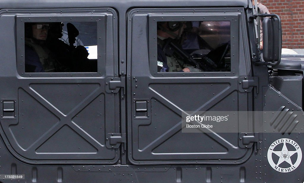 Marshall armored vehicle is part of the motorcade carrying alleged Boston Marathon bomber Dzhokhar Tsarnaev arrives at the John Joseph Moakley Courthouse in Boston, July 10, 2013.