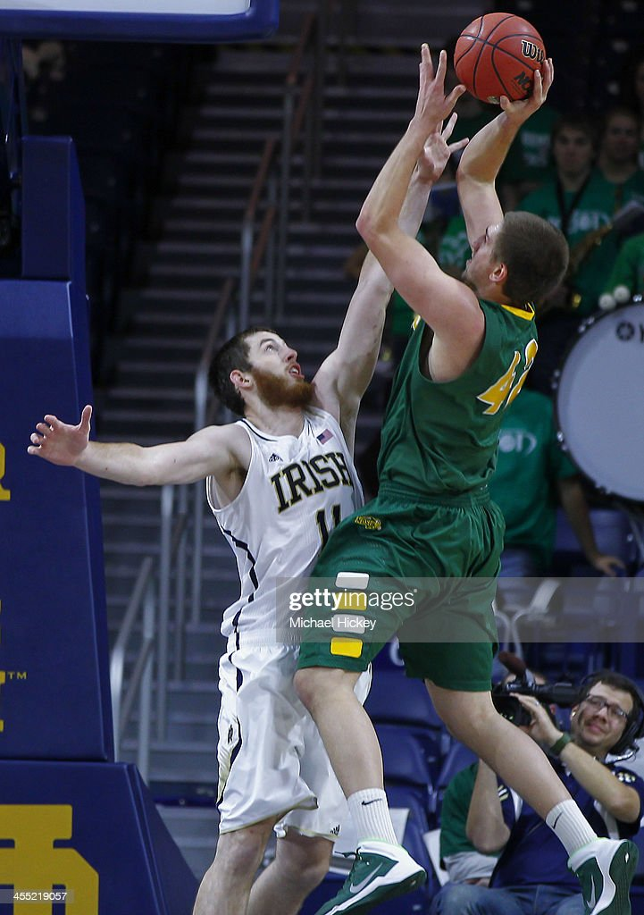 Marshall Bjorklund #42 of the North Dakota State Bison shoots the ball against Garrick Sherman #11 of the Notre Dame Fighting Irish at Purcel Pavilion on December 11, 2013 in South Bend, Indiana. North Dakota State defeated Notre Dame 73-69.
