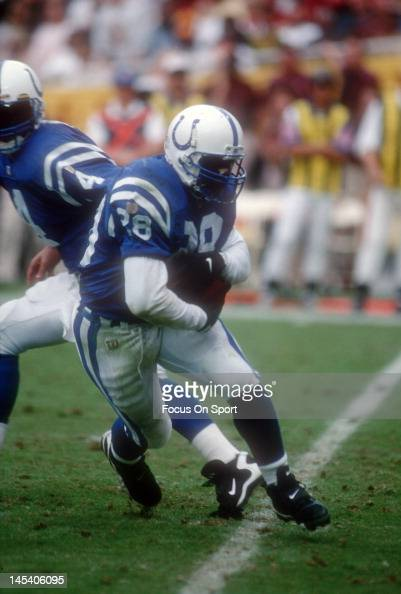 Marshall Faulk of the Indianapolis Colts carries the ball against the Washington Redskins during an NFL football game October 27 1996 at Robert F...