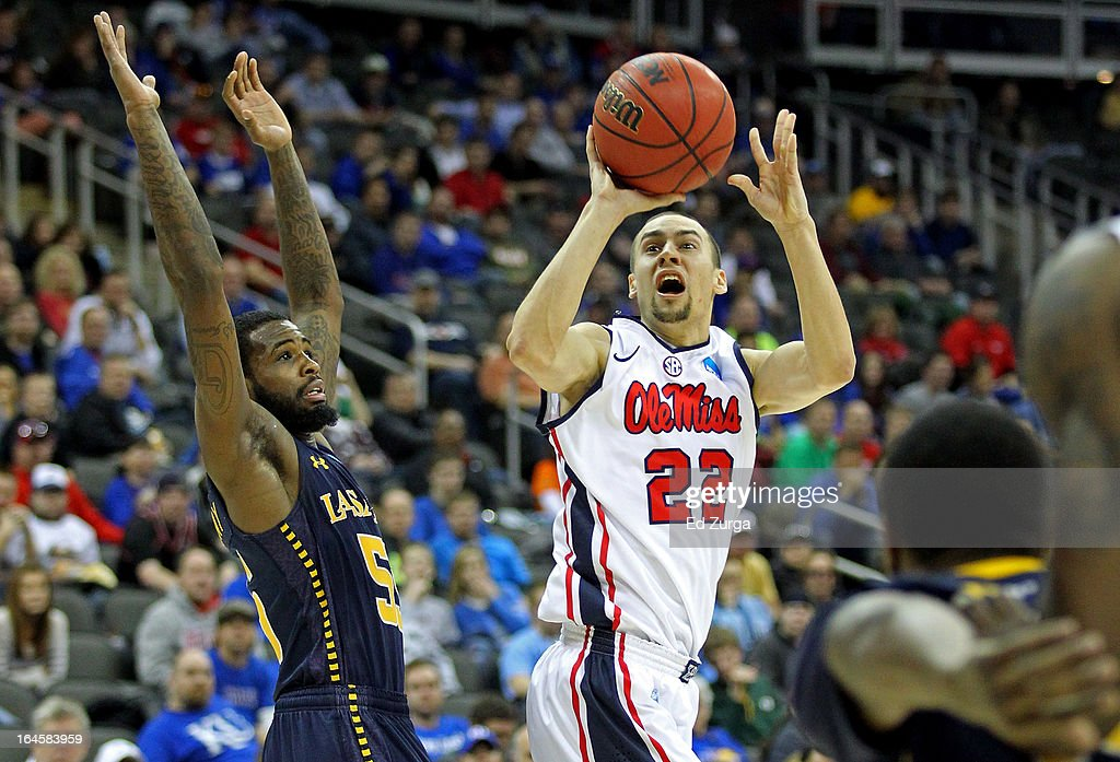 <a gi-track='captionPersonalityLinkClicked' href=/galleries/search?phrase=Marshall+Henderson&family=editorial&specificpeople=6694567 ng-click='$event.stopPropagation()'>Marshall Henderson</a> #22 of the Mississippi Rebels attempts a shot in the second half against Ramon Galloway #55 of the La Salle Explorers during the third round of the 2013 NCAA Men's Basketball Tournament at Sprint Center on March 24, 2013 in Kansas City, Missouri.