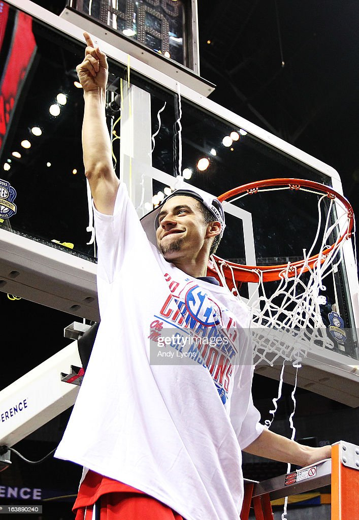 Marshall Henderson #22 of the Ole Miss Rebels celebrates by cutting down a piece of the net after their 66 to 63 win over the Florida Gators in the SEC Basketball Tournament Championship game at Bridgestone Arena on March 17, 2013 in Nashville, Tennessee.