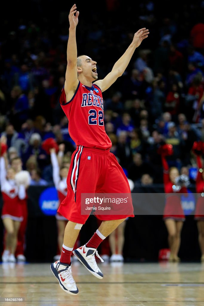 Marshall Henderson #22 of the Ole Miss Rebels celebrates their 57-46 win over the Wisconsin Badgers during the second round of the 2013 NCAA Men's Basketball Tournament at the Sprint Center on March 22, 2013 in Kansas City, Missouri.