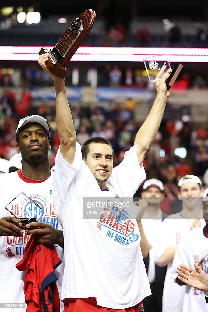 Marshall Henderson #22 of the Ole Miss Rebels celebrates their 66 to 63 win over the Florida Gators in the SEC Basketball Tournament Championship game at Bridgestone Arena on March 17, 2013 in Nashville, Tennessee.