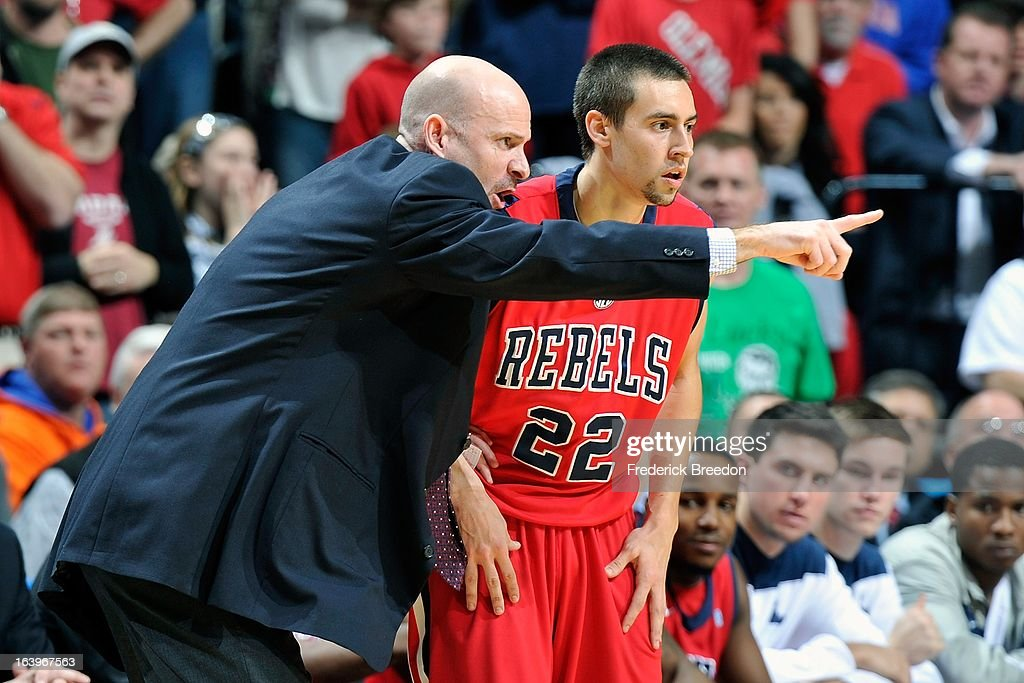 Marshall Henderson #22 of the Ole Miss Rebels gets information from head coach Andy Kennedy against the Florida Gators during the SEC Baskebtall Tournament Championship Game at Bridgestone Arena on March 17, 2013 in Nashville, Tennessee.