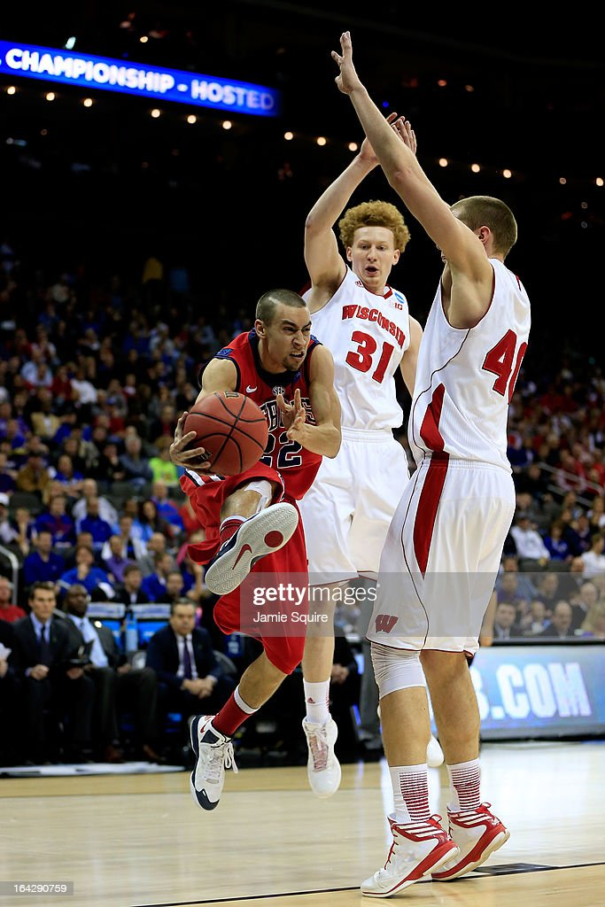 Marshall Henderson #22 of the Ole Miss Rebels shoots against Mike Bruesewitz #31 and Jared Berggren #40 of the Wisconsin Badgers in the second half during the second round of the 2013 NCAA Men's Basketball Tournament at the Sprint Center on March 22, 2013 in Kansas City, Missouri.