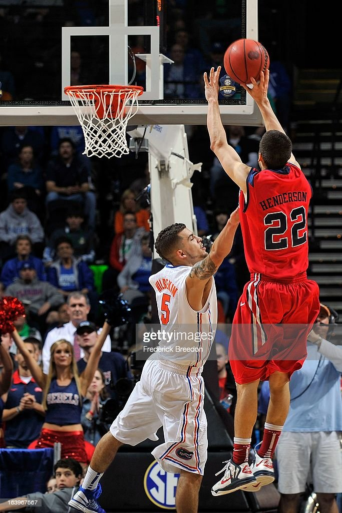 Marshall Henderson #22 of the Ole Miss Rebels takes a shot over Scottie Wilbekin #5 of the Florida Gators during the SEC Baskebtall Tournament Championship Game at Bridgestone Arena on March 17, 2013 in Nashville, Tennessee.