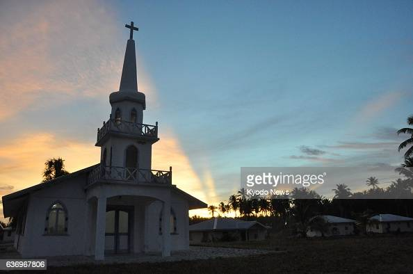 RONGELAP Marshall Islands A church stands against the sunrise glow in March 2014 in Rongelap an atoll of the Marshall Islands that was severely...